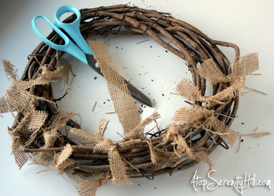 burlap on grapevine wreath...great base for any holiday theme! • AtopSerenityHill.com