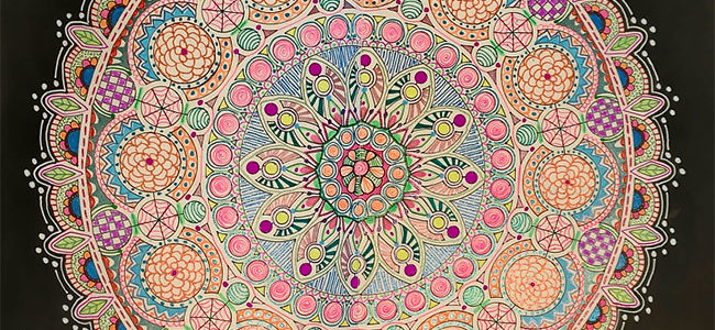 Create a mandala with gel pens and a stencil